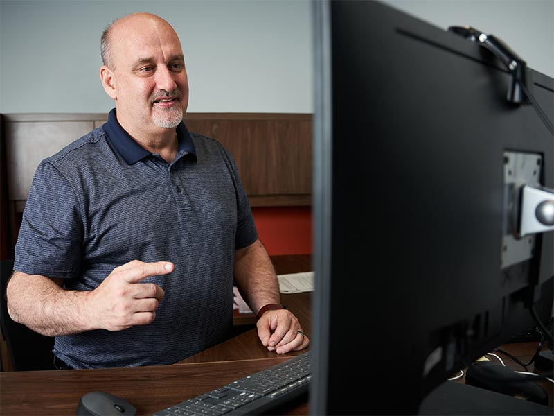 Online training in front of computer monitor